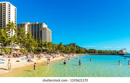 HONOLULU, HAWAII - FEBRUARY 16, 2018: View of the sandy city beach. Copy space for text