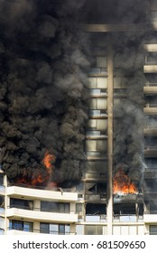 HONOLULU, HAWAII - JULY 14, 2017: A multiple alarm fire burns out of control in the Marco Polo apartment building located near Waikiki.