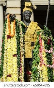 HONOLULU, HAWAII - JUNE 10, 2017: Close-up of the downtown landmark King Kamehameha statue covered in beautiful floral lei for the annual floral parade honoring the King.
