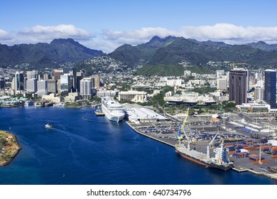 HONOLULU, HAWAII - MARCH 19, 2017: Aerial view of Honolulu Harbor and the downtown skyline. In the background are the Koolau Mountains.