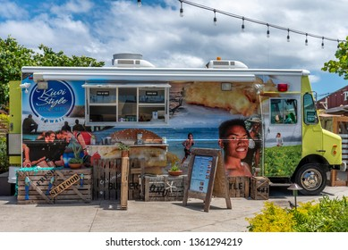 Honolulu, Hawaii - March 28, 2019: Food trucks at the Polynesian Cultural Center on the east shore of Oahu.  The Polynesian Cultural Center is a popular attraction.