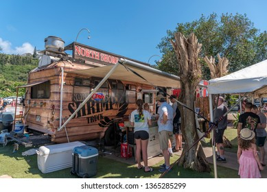 Honolulu, Hawaii - March 28, 2019: Food trucks on the North Shore of Oahu, Hawaii. The north shore is famous for its shrimp food trucks and is very popular with tourists and locals alike.