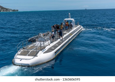 Honolulu, Hawaii - March 30, 2019: Submarine operated by  Atlantis Waikiki Submarine Adventure.  The hour submarine ride takes you to weeks and reefs just off famous Waikiki beach on Oahu, Hawaii.