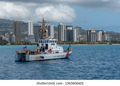 Honolulu, Hawaii - March 30, 2019: United States Coast Guard vessel off Waikiki Beach in Honolulu Hawaii.  Coast Guard is often positioned of Waikiki on busy weekends as there are many water users.