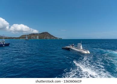Honolulu, Hawaii - March 30, 2019: Submarine operated by  Atlantis Waikiki Submarine Adventure.  The hour submarine ride takes you to weeks and reefs just off famous Waikiki beach on Oahu, Hawaii.