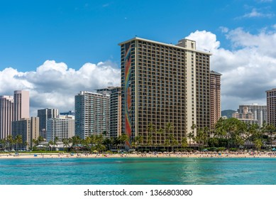 Honolulu, Hawaii - March 30, 2019: View of the famous Waikiki skyline from a boat out in the ocean. Hotels and beaches are visible.