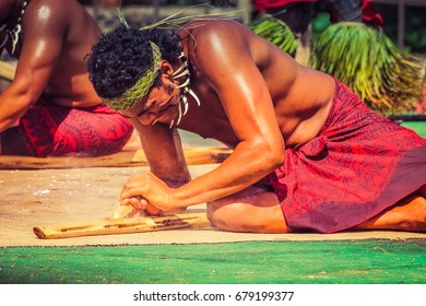Honolulu, Hawaii - May 27, 2016:A Samoan man demonstrates how to start fire by rubbing sticks in the village of Samoa at the Polynesian Cultural Center.