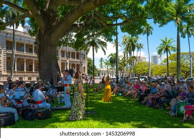 Honolulu, Hawaii - May 4,  2019:    Historic Center, an orchestra with singers plays traditional songs in the garden of the Royal Iolani Palace