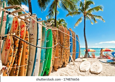 HONOLULU, HAWAII - SEPTEMBER 7, 2013: Surfboards lined up in the rack at famous Waikiki Beach in Honolulu. Oahu, Hawaii.