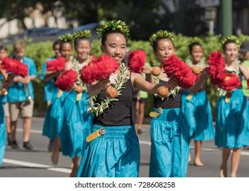 Honolulu, Hawaii, USA, 30.Sep, 2017: Hula dancers marching along Kalakaua Avenue to celebrate 71st Aloha Festival