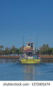 Honolulu, Hawaii, USA.  Apr. 17, 2019.  Tourists leaving the Ala Wai Harbor on a fishing boat enroute to Waikiki.