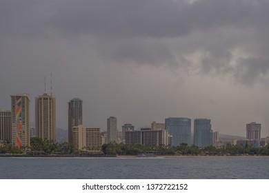 Honolulu, Hawaii, USA.  Apr. 17, 2019.  Offshore Waikiki panorama as a Spring trade wind shower engulfs the island.