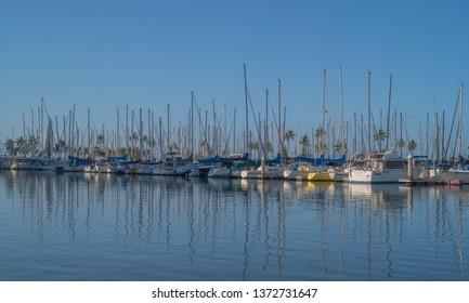 Honolulu, Hawaii, USA.  Apr. 17, 2019.  Yachts reflected in the calm turquoise waters in Waikiki.