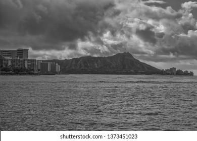 Honolulu, Hawaii, USA.  Apr. 18, 2019.  Monochrome view of Waikiki under trade wind rain showers with Diamond Head in the backdrop.