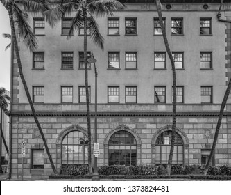 Honolulu, Hawaii, USA.  Apr. 19, 2019.  Black and white view of a century old building in the Financial District.