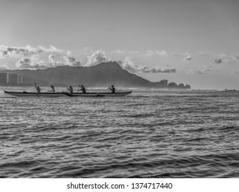 Honolulu, Hawaii, USA.  Apr. 19, 2019.  Hawaiian outrigger canoe with Diamond Head  and Waikiki in the background.