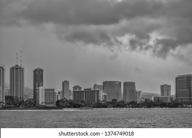 Honolulu, Hawaii, USA.  Apr. 19, 2019.  Tropical rain storm above Oahu and moving towards Waikiki on a warm and windy Spring day.