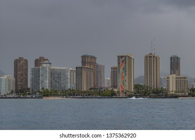 Honolulu, Hawaii, USA.  Apr. 20, 2019.  Warm Rain above Waikiki hotels and shoreline.