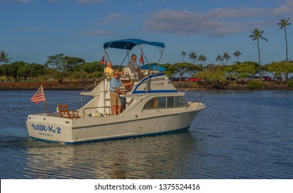 Honolulu, Hawaii, USA.  Apr. 20, 2019.  Restored 1950's sport fishing boat with old fishermen in Waikiki.
