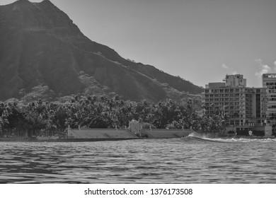 Honolulu, Hawaii, USA.  Apr. 21, 2019.  Offshore view of the Waikiki swim stadium with Diamond Head luxury condominiums adjacent.