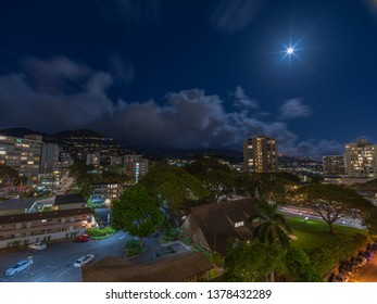 Honolulu, Hawaii, USA.  Apr. 23, 2019.  Late night moonrise above the Manoa Valley District.