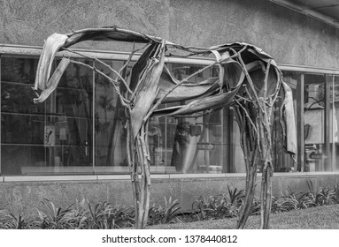 Honolulu, Hawaii, USA.  Apr. 23, 2019.  Pale horse statue constructed of palm tree materials and displayed on Bishop Street.