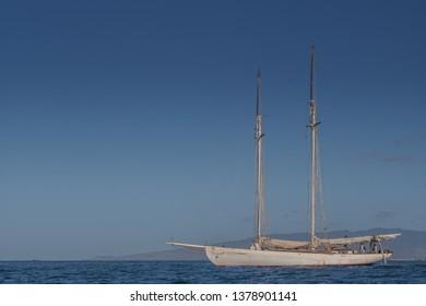 Honolulu, Hawaii, USA.  Apr. 24, 2019.  Traditional schooner sailboat leaving the Ala Wai Harbor on a voyage to Tahiti.
