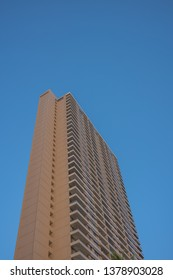 Honolulu, Hawaii, USA.  Apr. 24, 2019.  New Waikiki skyscraper condominium against a turquoise blue sky.