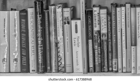 Honolulu, Hawaii, USA, April 2, 2017:  Vintage books about literature and science on a white bookshelf.