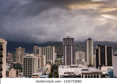Honolulu, Hawaii / USA - August 26, 2018: Aerial view of amazing cloudscape over Waikiki tall buildings as aftermath of Hurricane Lane lingers.