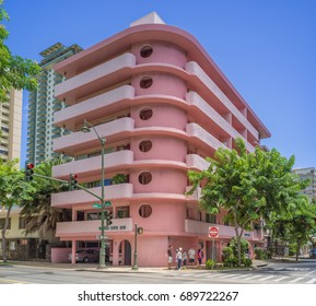 Honolulu, Hawaii, USA, August 4, 2017:  Waikiki early 1950's condominium now restored and painted in the original pink and white colors.