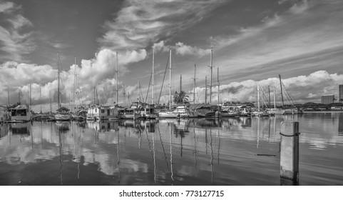 Honolulu, Hawaii, USA,  Dec. 12, 2017.  Winter morning panorama at the Ala Wai Harbor with new visiting sailboats from Canada.