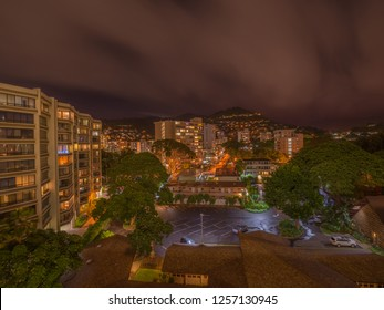 Honolulu, Hawaii, USA.  Dec. 13, 2018.  Makiki and Manoa District of Honolulu Town under light rain showers in a night time lapse photograph.