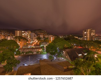 Honolulu, Hawaii, USA.  Dec. 14, 2018.  Night time lapse view of Manoa under tropical rain showers.