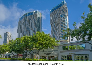 Honolulu, Hawaii, USA.  Dec. 18, 2019.  Twin towers of the new Waikiki Ritz Carlton Residence Hotel with Kalakauala  Avenue in the foreground.