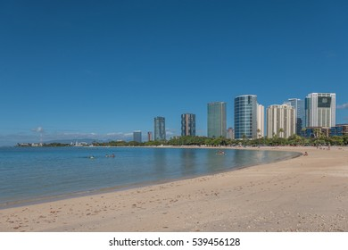 Honolulu, Hawaii, USA, Dec. 19, 2016:  Winter morning view of the shoreline at Ala Moana Beach Park with Honolulu skyscrapers in the background.