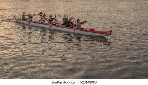 Honolulu, Hawaii, USA, Dec. 3, 2016:  Outrigger canoe with a crew of young ladies heading out for a paddle around Waikiki.