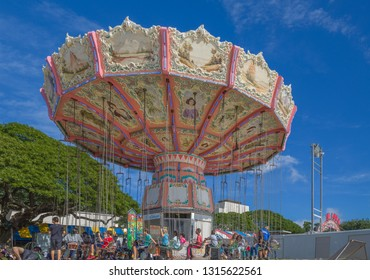 Honolulu, Hawaii, USA.  Feb. 18, 2019.  People boarding a thrill ride at the Punahou School Winter Carnival.