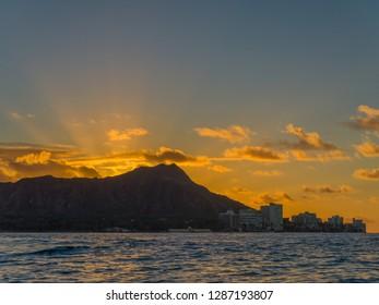 Honolulu, Hawaii, USA.  Jan. 17, 2019.  Ocean view of Diamond Head Crater at sunrise on a windy day in Waikiki.