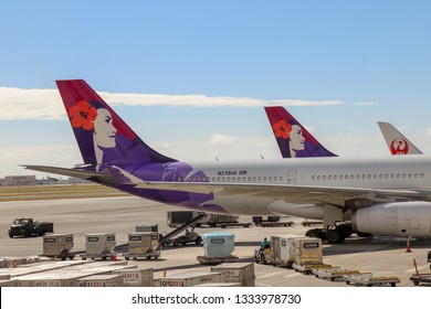 Honolulu, Hawaii, USA January 12, 2019 Hawaiian Airlines planes at Daniel K. Inouye International Airport.