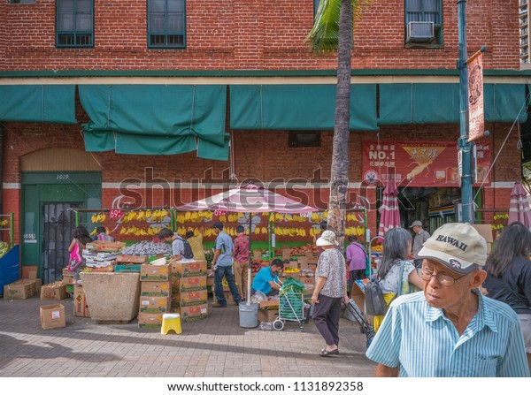 Honolulu, Hawaii, USA.  July 11, 2018.  Honolulu Chinatown Open Market selling farm fresh fruits and vegetables.