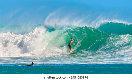 Honolulu, Hawaii, USA - July 14, 2019: The south shore of the island of Oahu is home to the thumping barrels of the Ala Moana Bowls surf spot.