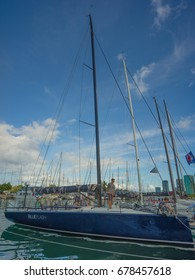 Honolulu, Hawaii, USA, July 17, 2017:  Transpacific Yacht Race view of a sleek racing sailboat putting away wails and gear after completing the race.