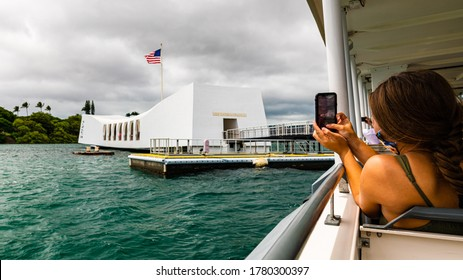 Honolulu, Hawaii, USA - July 19, 2020: Visitors are now required to wear face masks and practice social distancing at all times while transiting to and from the USS Arizona Memorial in Pear Harbor