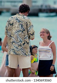 "Honolulu, Hawaii, USA, July 20, 1999  First day of filming ""BayWatch Hawaii.  David Hasselhoff poses for pictures with tourists while filming of the new series of ""Baywatch"" at the Hilton Village"