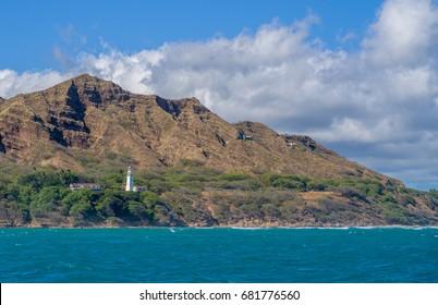 Honolulu, Hawaii, USA, July 21, 2017:  Diamond Head panorama of the lighthouse with the waters of Waikiki in the foreground.