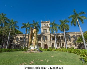 Honolulu, Hawaii, USA.  June 12, 2019.  Restored Honolulu Court House with the statue of King Kamehameha adorned with flower leis.
