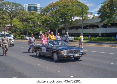 Honolulu, Hawaii, USA, June 14, 2016:  Governor David Ige and wife Dawn Ige, riding in the 100th Annual Kamehameha Day Parade.