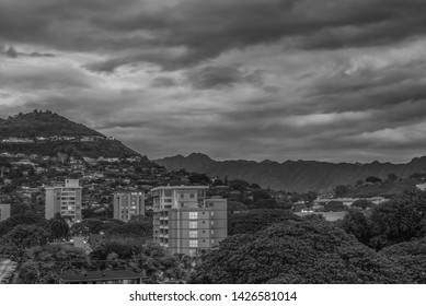 Honolulu, Hawaii, USA.  June 17, 2019.  Night time lapse in black and white off Roundtop Mountain and the Manoa Valley to photo right.