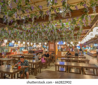 Honolulu, Hawaii, USA, June 19, 2017:   New Food Court at Ala Moana Center with Asian furnishings and hanging vines.